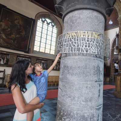 A mother and her child in one of the many churches in Bruges, Belgium